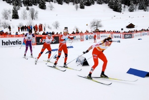 Kowalczyk leading Johaug, Bjoergen and Ishida early in the women's 10km Classic race.