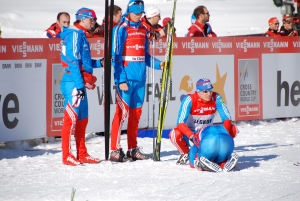 Chernousov being consoled by Russian his teammates