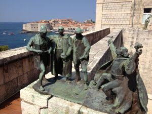 "Mihanovic's sculpture ""Brotherhood"" (1917), with Dubrovnic's old town behind."