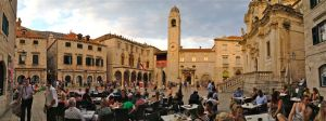 Luza Square boasts a busy cafe culture, with the 15th century clock tower rising behind.