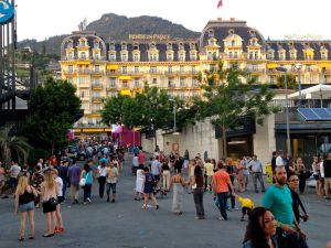 Festival goers outside the Miles Davis Hall, with the spectacular Montreux Palace Hotel behind.