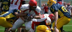 Lachlan rushing the ball in a game against the Lugano Lakers.
