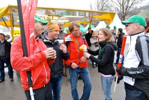Brevet's Tom Eeles sharing a beer with guests in the race village at Les Diablerets.