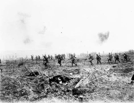 Canadian forces moving across the devastated landscape of Vimy Ridge.