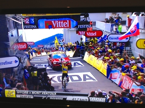 Froome celebrates the stage win on the Ventoux, on Bastille Day. How fitting.