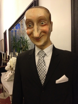 The hotel Maitre de, perhaps creepier than de Sade himself.