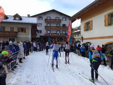 Competitors race right down the main street of half a dozen towns and villages along the Marcialonga course.