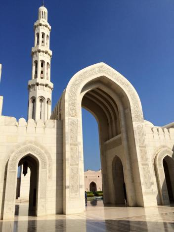 Arch near the entrance to the main prayer hall, with the mosque's main minaret behind.
